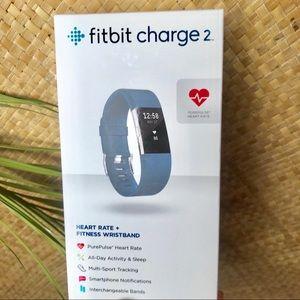 Blue fit bit watch. Like new. Worn 2-3 times